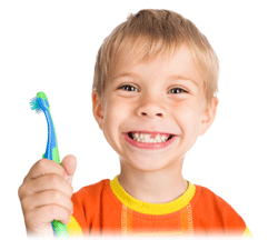 Young child smiling holding toothbrush